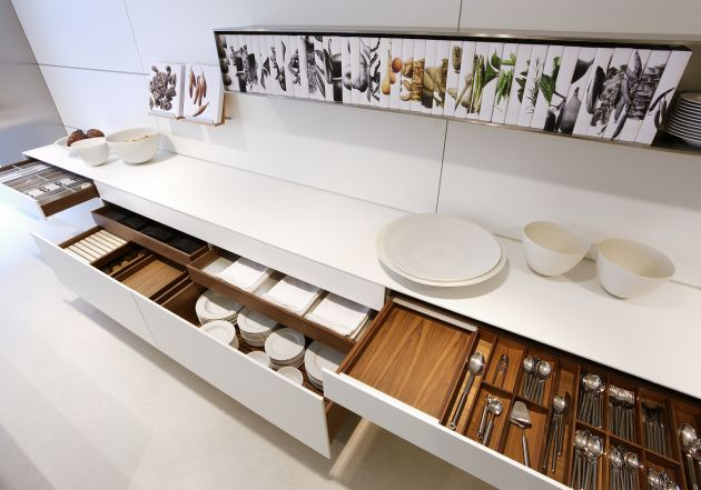 Wooden Accent Of The Drawer From White Kitchen